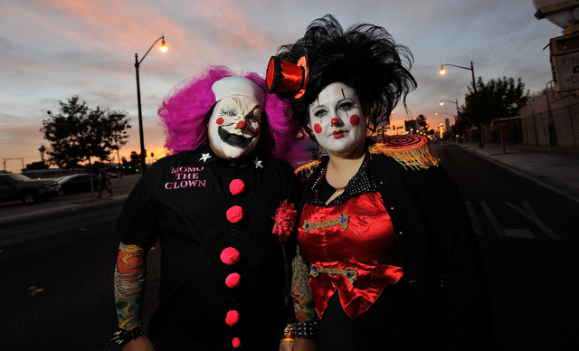 Alex Kalaw, left and Anna Fintikakis pose before the start of the 5th annual Halloween parade along East Fremont Street in Las Vegas on Friday, Oct. 31, 2014. (David Becker/Las Vegas Review-Journal)