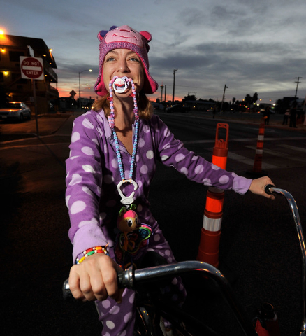 Hope Epert dons her purple pok-a-dot pajamas for the 5th annual Halloween parade along East Fremont Street in Las Vegas on Friday, Oct. 31, 2014. (David Becker/Las Vegas Review-Journal)