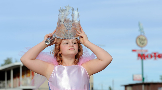 """Morgane Rexroad, 10, dons her crown as she dresses like 'The Wizard of Oz's"""" good witch of the north before the start of the 5th annual Halloween parade along East Fremont Street in Las Vegas ..."""
