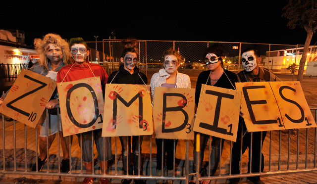 The Scrabble zombies from left, Wendy Mathre, Mikey Otto, Makaela Otto, Brianna Mathre, Wendy Otto and Carlos Lopez line up to watch the 5th annual Halloween parade along East Fremont Street in La ...