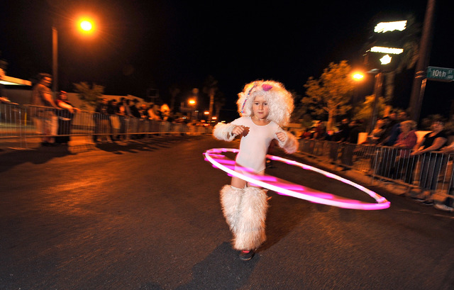 Padi Anonima, 7, swings her Hula-Hoop as she walks during the 5th annual Halloween parade along East Fremont Street in Las Vegas on Friday, Oct. 31, 2014. (David Becker/Las Vegas Review-Journal)