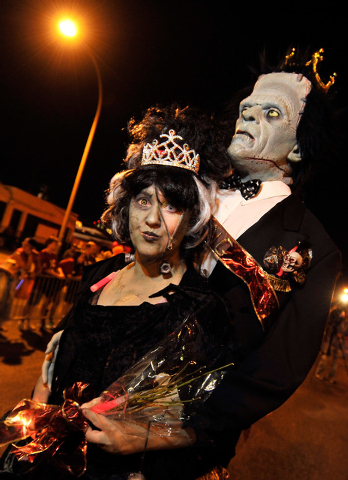 Jennifer Neri, with her prom date, Frankenstein, walk during the 5th annual Halloween parade along East Fremont Street in Las Vegas on Friday, Oct. 31, 2014. (David Becker/Las Vegas Review-Journal)