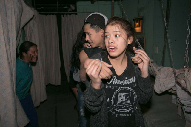 Victims react to a scare by actor Cristal Montes inside The Asylum of Terror at the Meadows Mall in Las Vegas, Nev. on Oct. 3, 2013. This Halloween season sees the long-running haunted houses, Hot ...