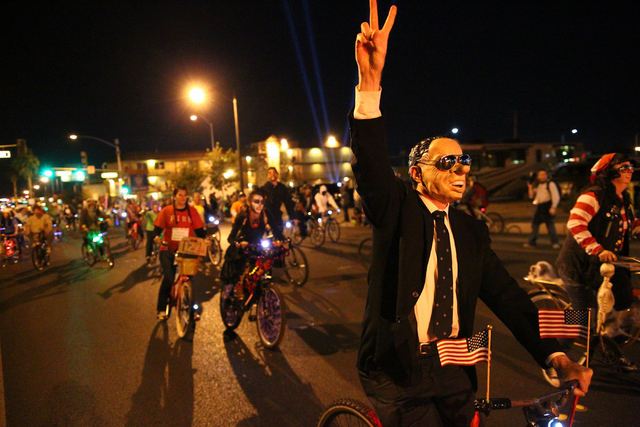 Costumed participants on bicycles make their way down Fremont Street at the beginning of the Las Vegas Halloween Parade near downtown Las Vegas on Thursday, Oct. 31, 2013. (Chase Stevens/Las Vegas ...