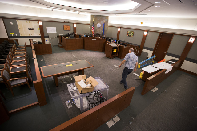 Wayne Slater, AV manager for Regional Justice Center walks in inside courtroom 14-C on Friday, Oct. 17,2014. Court personnel are preparing for a yearlong trial involving the faulty construction of ...