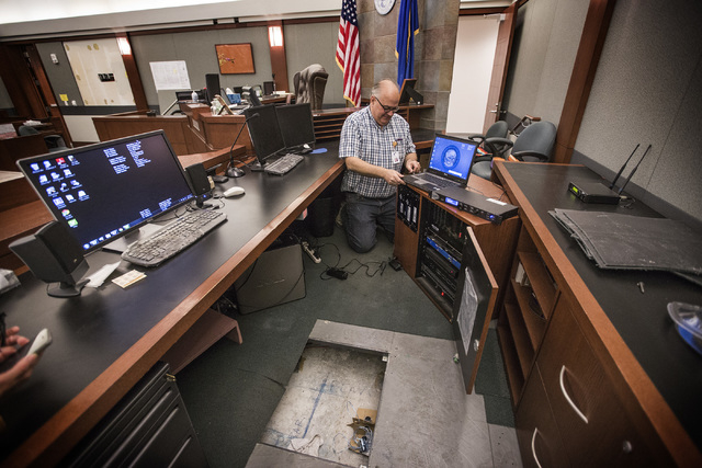 Wayne Slater, AV manager for Regional Justice Center wires courtroom 14-C on Friday, Oct. 17,2014. Court personnel are preparing for a yearlong trial involving the faulty construction of the Harmo ...