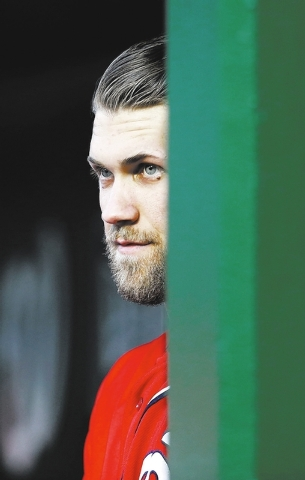 Washington Nationals left fielder Bryce Harper (34) pauses in the dugout during a baseball game against the Atlanta Bravesat Nationals Park Saturday, April 5, 2014, in Washington. (AP Photo/Alex B ...