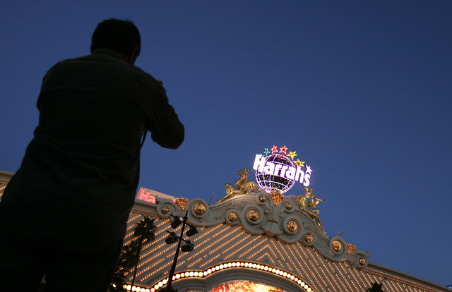 A tourist takes a picture of Harrah's Las Vegas hotel-casino on the Strip in Las Vegas. Manuel Espronceda, 54, confessed to going too far in sending death threats to his Harrah's supervisor afte ...