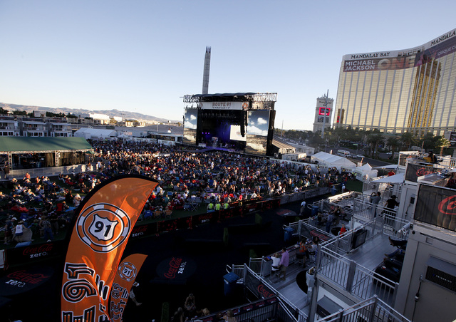 Fans listen to Dustin Lynch perform at the Route 91 Harvest country music festival at the MGM Resorts Village in Las Vegas on Sunday, October 5, 2014. (Justin Yurkanin/Las Vegas Review-Journal)