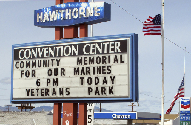 A sign telling residents about a memorial service is posted at the Convention Center in Hawthorne, Nev., near the Hawthorne Army Depot on Tuesday, March 19, 2013, where seven Marines were killed a ...