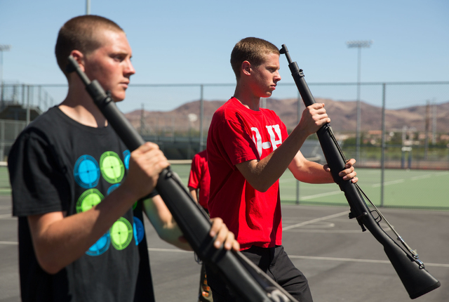 Basic High School Junior ROTC members James Werner, 16, left, and Colby Cazett, 17, right, practice their armed drill team program at the high school Friday, Sept. 19, 2014. (Samantha Clemens-Kerb ...