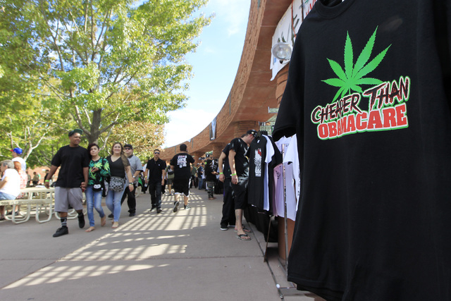 People walk past vendor booths during the first annual Hemp Fest Saturday, Oct. 4, 2014 at the Clark County Government Center. (Sam Morris/Las Vegas Review-Journal)