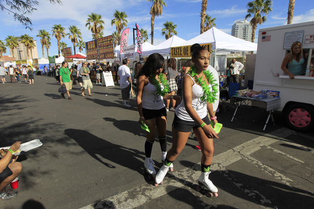Women roller skate past food booths during the first annual Hemp Fest Saturday, Oct. 4, 2014 at the Clark County Government Center. (Sam Morris/Las Vegas Review-Journal)