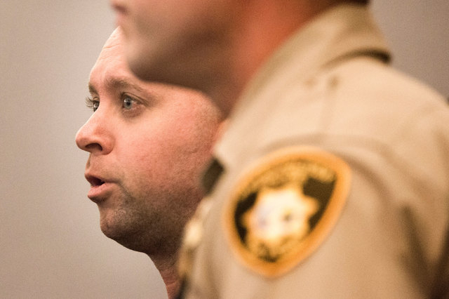 Metro officer James Henry, 37, left, appears in Las Vegas Justice court on Friday, Oct. 24, 2014. He faces 10 counts each of possession of child pornography and distribution of child pornography.  ...