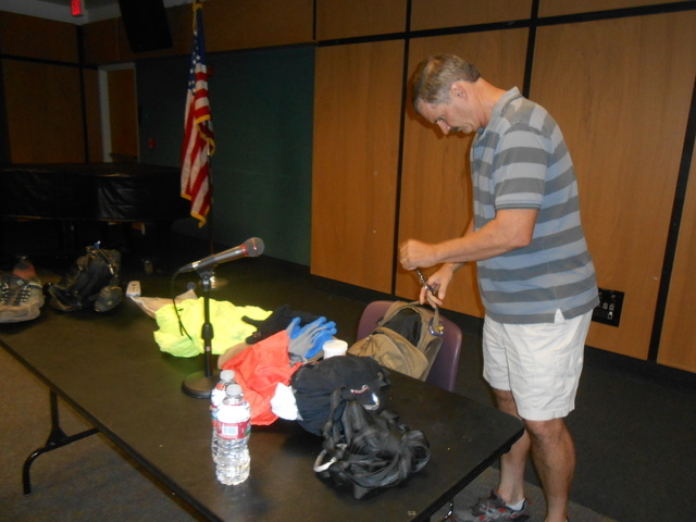 Branch Whitney pulls his must-carry items out of his backpack Sept. 9, 2014, during a presentation at the Rainbow Library, 3150 N. Buffalo Drive. Whitney, an author and expert on hikes and scrambl ...