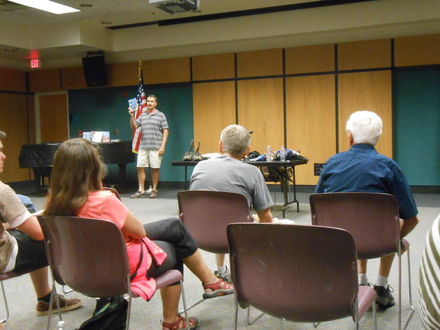 Branch Whitney speaks before about 75 people Sept. 9, 2014, at the Rainbow Library. Whitney has hiked and climbed more than 3,000 miles and is considered an expert on hikes and scrambling routes a ...