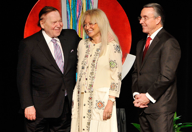 Las Vegas Sands Corp. Chairman and CEO Sheldon Adelson, left, accompanied by his wife, Dr. Miriam Adelson, is honored by UNLV acting president Don Snyder for his continued support of UNLV during t ...