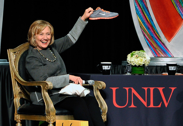 Former Secretary of State Hillary Clinton holds up a single running shoe she received as a gift during the 2014 UNLV Foundation Annual Dinner at the Bellagio hotel-casino on Monday, Oct. 13, 2014. ...