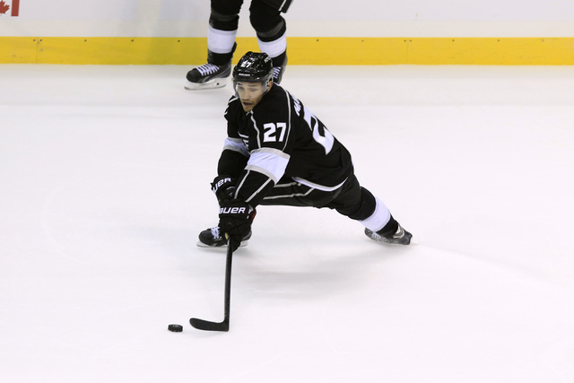 Los Angeles Kings defenseman Alec Martinez reaches for the puck during their pre-season game against the Colorado Avalanche Saturday, Oct. 4, 2014 at the MGM Grand Garden Arena. (Sam Morris/Las Ve ...
