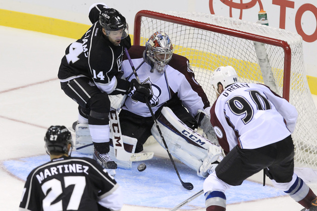 Los Angeles Kings right wing Justin Williams tries to get a shot past Colorado Avalanche Semyon Varlamov during their pre-season game Saturday, Oct. 4, 2014 at the MGM Grand Garden Arena. The Aval ...