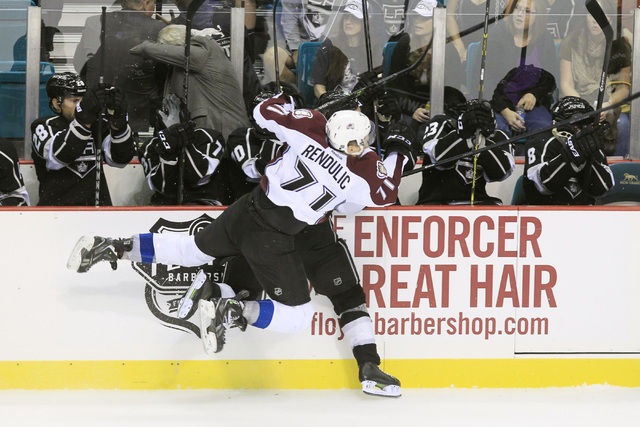 Colorado Avalanche right wing Borna Rendulic checks Los Angeles Kings defenseman Robyn Regehr into the boards during their pre-season game Saturday, Oct. 4, 2014 at the MGM Grand Garden Arena. The ...