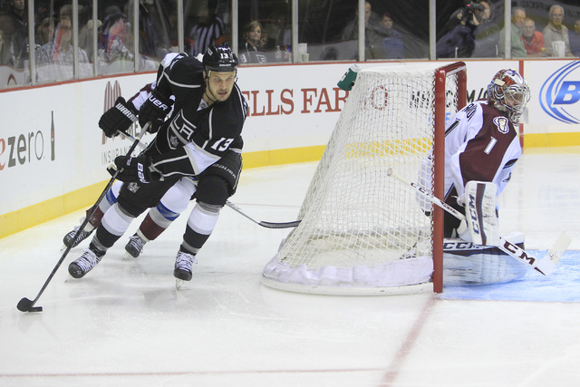 Los Angeles Kings Kyle Clifford brings the puck around the net during their pre-season game against the Colorado Avalanche Saturday, Oct. 4, 2014 at the MGM Grand Garden Arena. The Avalanche won 3 ...