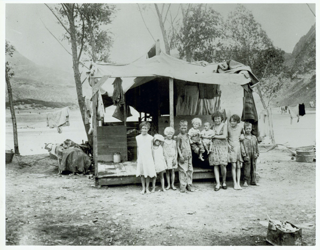 An unidentified family poses outside a home in 1931, in the tent city known as Ragtown, which was a hastily assembled town near the Hoover Dam construction site in Black Canyon before Boulder City ...