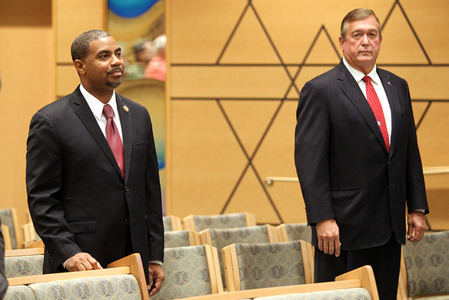U.S. Rep. Steven Horsford, D-Nev., left, and his Republican challenger, Assemblyman Cresent Hardy, R-Mesquite, listen to opening remarks before debating during a candidate forum at Temple Sinai in ...