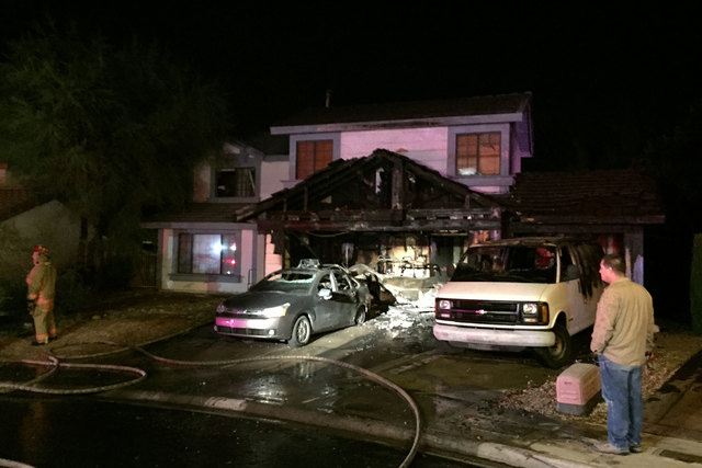 Two people escaped their home at 8913 Rocky Shore Dr., near Fort Apache and Desert Inn roads, early Friday morning, Oct. 31, 2014, after a fire started in the garage. The garage was gutted and fou ...