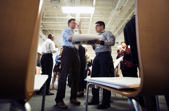 UNLV Interior Design Student Juan Medrano,right, Listens While Ryan R.  Walsh,