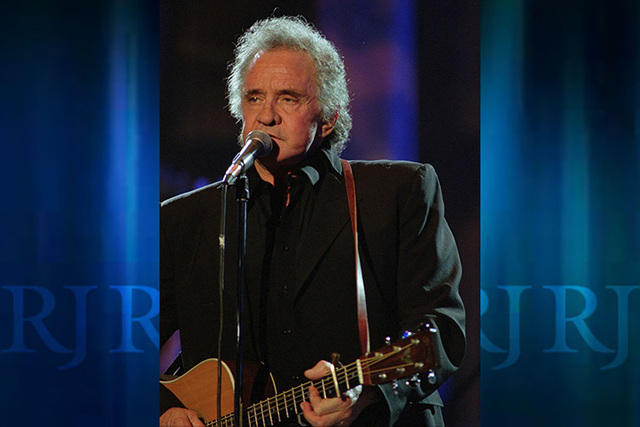 In this Sept. 2, 1995 file photo, Johnny Cash performs during his segment of the Concert for the Rock and Roll Hall of Fame in Cleveland.  The city of Folsom has completed the first section of its ...