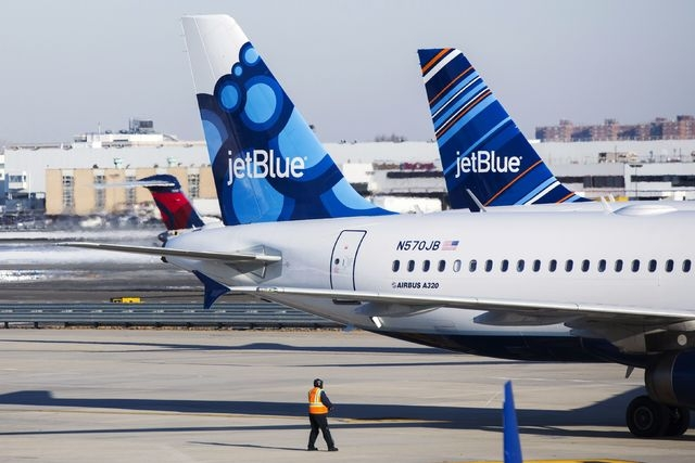 A New Hampshire woman says she was removed from a JetBlue flight after tweeting about the flight's delays, which included a pilot having to take a sobriety test. (Reuters/Lucas Jackson)
