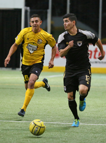Las Vegas Legends' Felipe Gonzalez, right, has control of the ball during a Major Arena Soccer League season opener against Turlock Express at Orleans Arena Sunday, Oct. 26, 2014, in Las Vegas. Tu ...