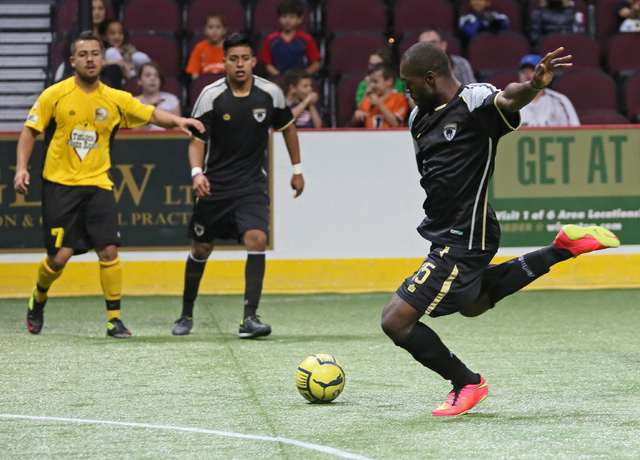 Las Vegas Legends' Uzi Tayou, right, goes for a kick during a Major Arena Soccer League season opener against Turlock Express at Orleans Arena Sunday, Oct. 26, 2014, in Las Vegas. Arturo Pulido, f ...