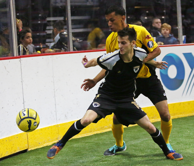 Las Vegas Legends' Ricardo Sobreira, front, goes for the ball past Turlock Express' Jorge Carmona during a Major Arena Soccer League season opener at Orleans Arena Sunday, Oct. 26, 2014, in Las Ve ...
