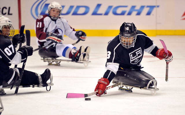 Los Angeles King Wesley Barnientos brings the puck up the ice during his sled hockey game against the Colorado Avalanche at the MGM Grand Garden Arena on Friday, Oct. 3, 2014. (David Becker/Las Ve ...