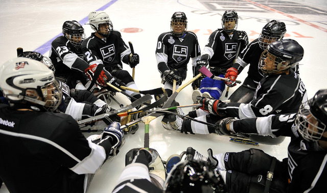 The Los Angeles Kings sled hockey squad gather for a pre-game cheer before they take on the Colorado Avalanche at the MGM Grand Garden Arena on Friday, Oct. 3, 2014. (David Becker/Las Vegas Review ...