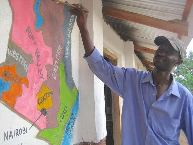 """The real Kay Kay, the inspiration behind """"Kay Kay's Alphabet Safari,"""" paints a mural. (Special to View)"""