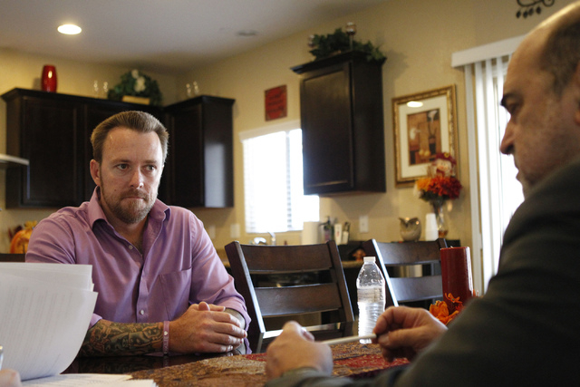 Jason Lamberth, left, and his attorney, Allen Lichtenstein, talk about the wrongful death lawsuit the Lamberth family is filing against the Clark County School District at the family's home in Hen ...