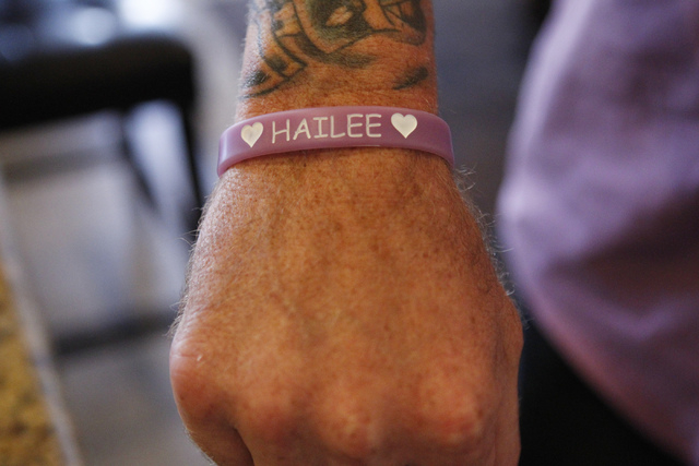 Jason Lamberth shows a wristband his family designed in memory of his daughter, Hailee, during an interview at his home in Henderson Tuesday, Oct. 21, 2014. Jason Lamberth and his wife, Jennifer,  ...
