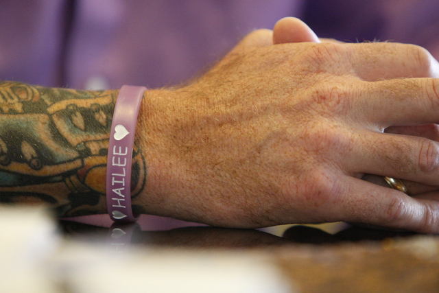 Jason Lamberth wears a wristband in memory of his daughter, Hailee, as he is interviewed about the wrongful death lawsuit his family is filing against the Clark County School District at their hom ...