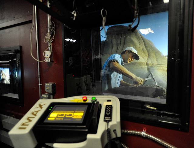 The IMAX control panel is seen inside a projection booth as a clip of a movie trailer is seen on the big screen at the Brenden Theatres inside the Palms hotel-casino on Tuesday, Oct. 28, 2014. (Da ...