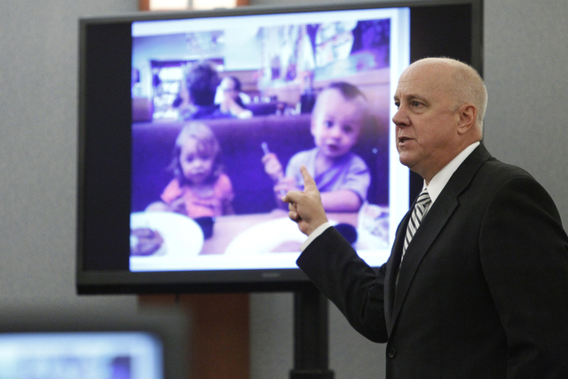 David Stanton, Clark County district attorney, speaks during closing arguments in the trial of Michael Lee at the Regional Justice Center in Las Vegas Friday, Aug. 15, 2014. Lee is accused in the  ...