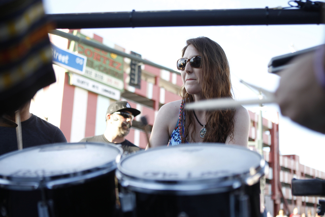 Christina Lakis plays the drums with a group of people during day two of the Life Is Beautiful music and art festival in downtown Las Vegas Saturday, Oct. 25, 2014. (Erik Verduzco/Las Vegas Review ...