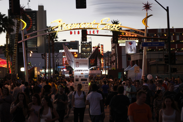 People walk near the intersection Fremont Street and 7th Street in downtown Las Vegas during day two of the Life Is Beautiful music and art festival in downtown Las Vegas Saturday, Oct. 25, 2014.  ...