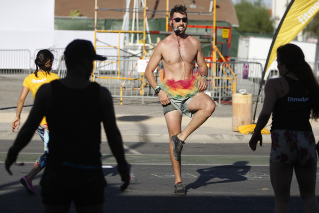 Yoga instructor Nick Palladino leads a public yoga session during day two of the Life Is Beautiful music and art festival in downtown Las Vegas Saturday, Oct. 25, 2014. (Erik Verduzco/Las Vegas Re ...