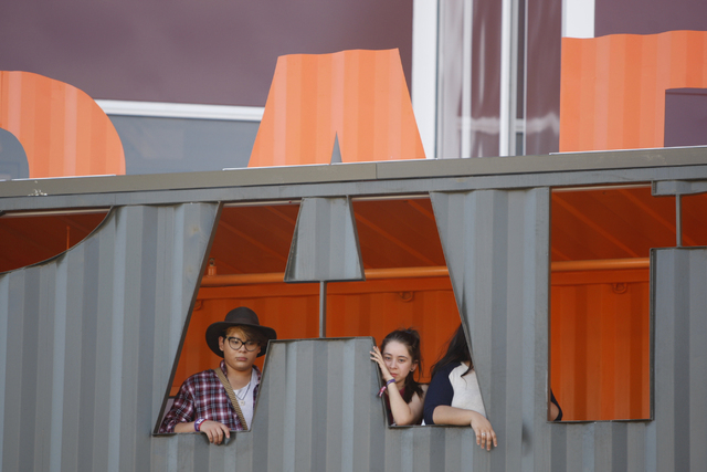 People watch the crowd from the Container Park during day two of the Life Is Beautiful music and art festival in downtown Las Vegas Saturday, Oct. 25, 2014. (Erik Verduzco/Las Vegas Review-Journal)