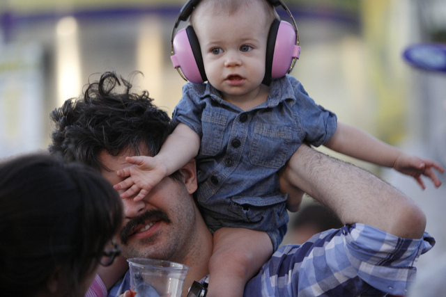Patrick Wall carries his 9-month-old daughter Iris during day two of the Life Is Beautiful music and art festival in downtown Las Vegas Saturday, Oct. 25, 2014. (Erik Verduzco/Las Vegas Review-Jou ...