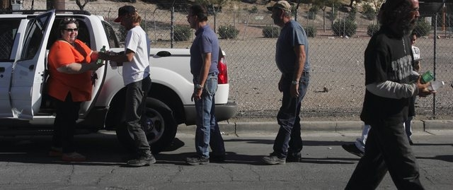 Homeless advocate Linda Lera-Randle El, founder and director of the Straight From the Streets charity, laughs while handing out water to homeless men in Las Vegas, Wednesday morning, Aug. 25, 2004 ...