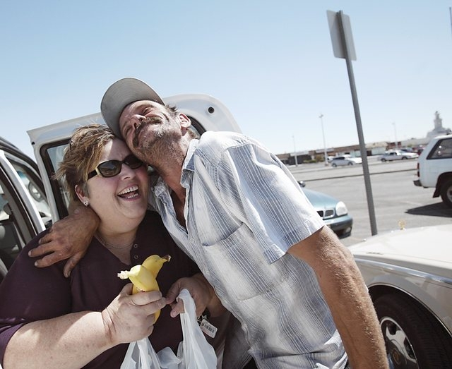 Homeless advocate Linda Lera-Randle El, left, receives a hug from Terry, a homeless man who lives near the Commercial Center, as she brings food to Huntridge Circle Park in Las Vegas, Thursday, Se ...
